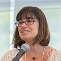 A photo of April Bellafiore speaking at a conference